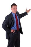 Young Businessman Presenting. Your Product Or Service, Isolated Over White Royalty Free Stock Photos