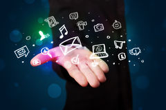 Young businessman presenting colorful glowing social media icons Royalty Free Stock Images