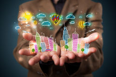 Young businessman presenting colorful hand drawn metropolitan ci Royalty Free Stock Photo
