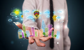 Young businessman presenting colorful hand drawn metropolitan ci Stock Photography