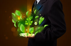 Young businessman presenting eco green leaf recycle energy conce Stock Image