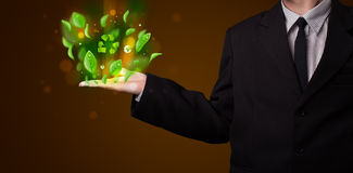Young businessman presenting eco green leaf recycle energy conce Royalty Free Stock Photos