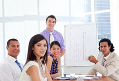 Young businessman presenting figures Stock Photo