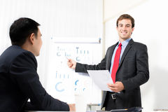 Young businessman presenting graphs Stock Images