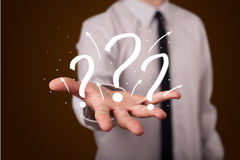 Young businessman presenting hand drawn question marks Stock Image