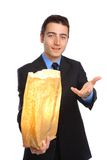 Young Businessman presenting hope. Yooung businessman presenting a bag for hope stock image