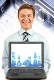 Young businessman presenting a laptop Royalty Free Stock Photography