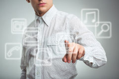 Young businessman pressing application button on computer with t Royalty Free Stock Photography