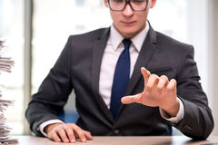 The young businessman pressing buttons in business concept Stock Image