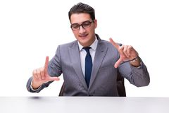 Young businessman pressing virtual buttons isolated on white bac Royalty Free Stock Photos