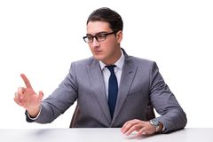 Young businessman pressing virtual buttons isolated on white bac Stock Photography