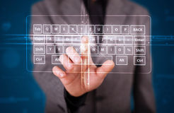 Businessman pressing virtual type of keyboard Royalty Free Stock Images