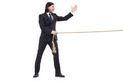 Young businessman pulling rope isolated Royalty Free Stock Photos