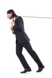 Young businessman pulling rope isolated Royalty Free Stock Images