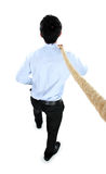 Young businessman pulling a rope while standing not facing the c Royalty Free Stock Photo