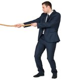 Young businessman pulling a rope Royalty Free Stock Images