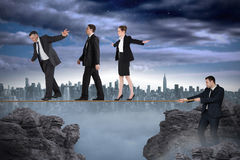 Young businessman pulling a tightrope for business people Royalty Free Stock Photos