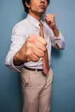 Young businessman punching Stock Photos