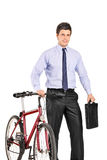 Young businessman pushing a bike Royalty Free Stock Photography