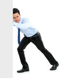 Young businessman pushing a blank board. On white background Royalty Free Stock Photography