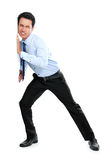 Young businessman pushing a blank board. On white background. ready for your design Stock Photo