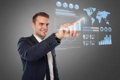 Young businessman pushing at virtual screen Royalty Free Stock Photo