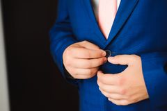Young businessman puts a suit on before meeting with partners. stock photo