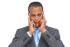Young businessman putting his fingers on his temples Royalty Free Stock Image