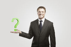 Young businessman with a question mark royalty free stock photos