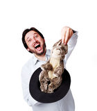 Young businessman with rabbit in hat Stock Image