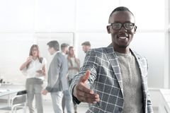 Young businessman reaching out for a handshake. Concept of partnership royalty free stock photos