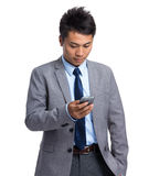 Young businessman read on cellphone Royalty Free Stock Photography