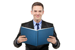A young businessman reading a book Royalty Free Stock Photo