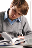 Young businessman reading book Stock Images