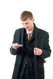 Young businessman reading a card Stock Image