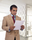 Young Businessman reading a document Stock Photos