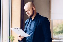 Young businessman reading documents in the office royalty free stock photography