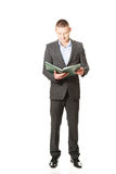 Young businessman reading his note book Stock Photography