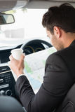 Young businessman reading a map Stock Images