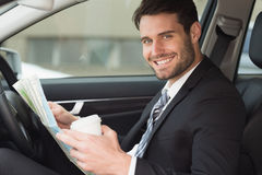 Young businessman reading a map Royalty Free Stock Photo
