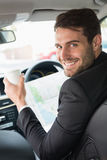 Young businessman reading a map Stock Photo