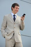 Young businessman reading messages Stock Image