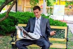 Young businessman reading a newspaper Stock Photos