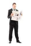 Young businessman reading a newspaper Royalty Free Stock Photo
