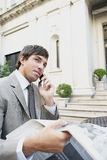 Businessman reading paper in cafe. Royalty Free Stock Photography