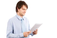 Young businessman reading a report Royalty Free Stock Photo