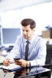 Young businessman reading a text message Stock Photos