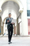 Young businessman receives a call from a new customer. Businessm Royalty Free Stock Photography