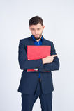 Young businessman with red folder Stock Image