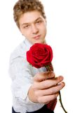 Young businessman with red rose Stock Photo